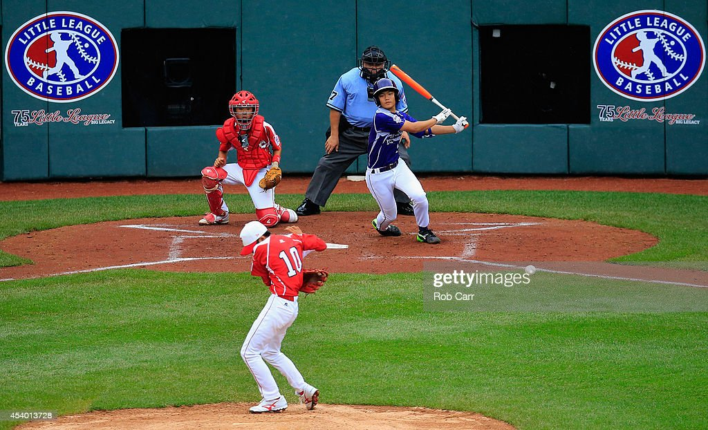 Dong Wan Sin #13 of Team Asia-Pacific follows his three RBI hit that lined off of pitcher Suguru Kanamori #10 of Team Japan during the second inning of the International Championship game of the Little League World Series at Lamade Stadium on August 23, 2014 in South Williamsport, Pennsylvania.