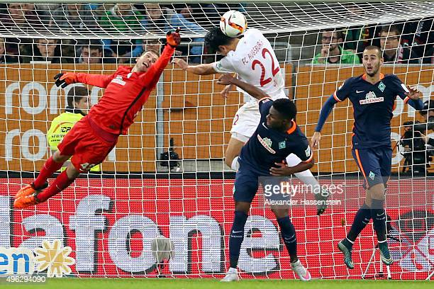 Dong Won Ji of Augsburg battles for the ball with Felix Wiedald keeper of Bremen and his team mates Ulisses Alexandre Garcia Lopes and Philipp...