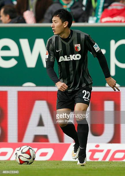 Dong Won Ji of Augsburg controls the ball the Bundesliga match between SV Werder Bremen and FC Augsburg at Weserstadion on February 14 2015 in Bremen...