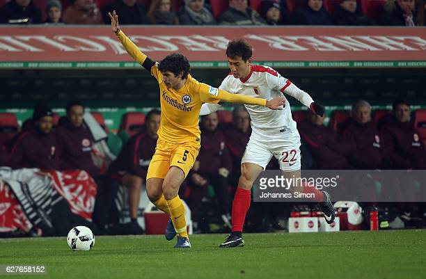 Dong Won Ji of Augsburg fights for the ball with Jesus Vallejo of Frankfurt during the Bundesliga match between FC Augsburg and Eintracht Frankfurt...