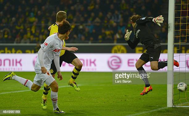 Dong Won Ji of Augsburg scores his teams second goal during the Bundesliga match between Borussia Dortmund and FC Augsburg at Signal Iduna Park on...