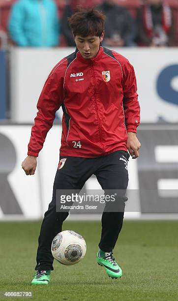 Dong Won Ji of Augsburg warms up before the Bundesliga match between FC Augsburg and Werder Bremen at SGL Arena on February 1 2014 in Augsburg Germany