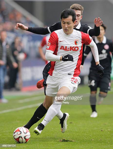 Dong Won Ji of FC Augsburg in action during the Bundesliga match betwen FC Augsburg and FSV Mainz 05 at SGL Arena on March 14 2015 in Augsburg Germany