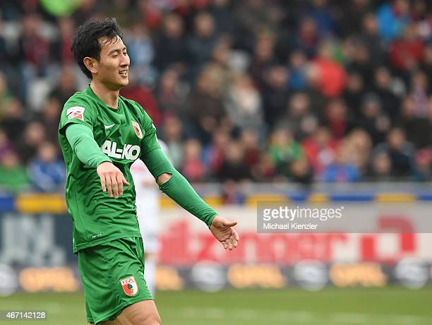 Dong Won Ji of FC Augsburg reacts during the Bundesliga match between SC Freiburg and FC Augsburg at SchwarzwaldStadium on March 21 2015 in Freiburg...