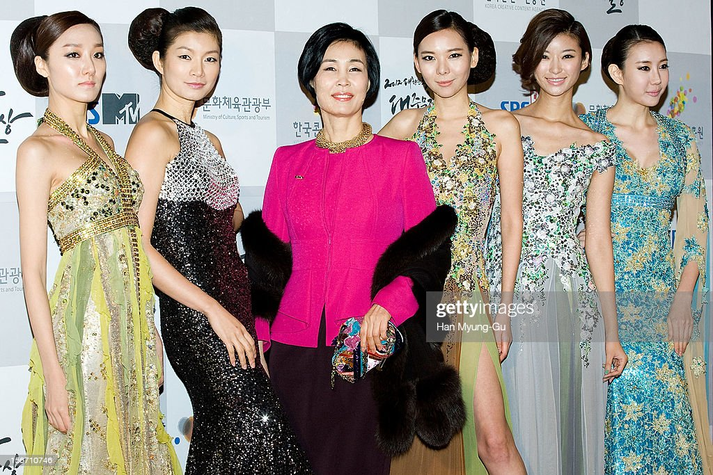 Dongduk Women's University Professor & model Kim Dong-Su (3nd L) and models attend during the 2012 Korea Popular Culture Art Awards at Olympic Hall on November 19, 2012 in Seoul, South Korea.