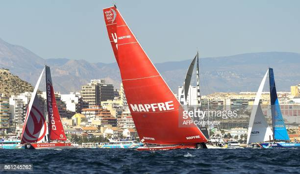 MAPFRE Dongfeng and Vestas 11th Hour racing teams sail off the coast of Alicante southeastern Spain on October 14 2017 during an inport race ahead of...