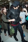 Donghae of boy band Super Junior M is seen upon arrival at the Gimpo Airport on October 28 2013 in Seoul South Korea