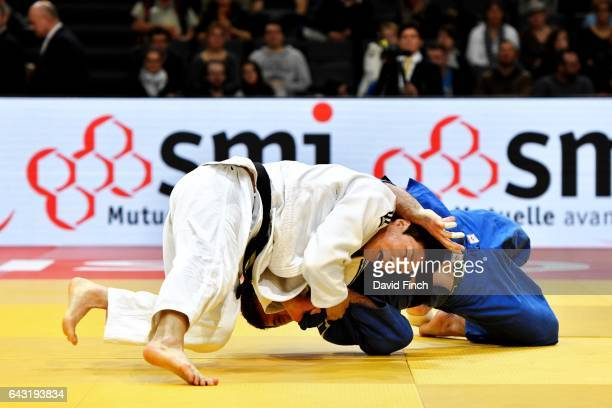 Donghan Gwak of South Korea throws Beka Gviniashvili of Georgia for the winning wazari to advance to the u90kg semifinal contest during the 2017...