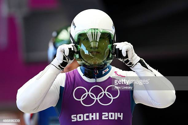 Donghyeon Kim of South Korea adjusts his helmet during a men's luge training session ahead of the Sochi 2014 Winter Olympics at the Sanki Sliding...