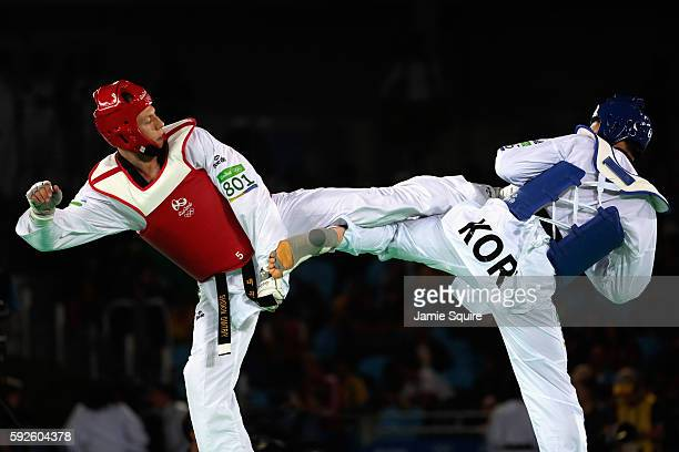 Dongmin Cha of Korea competes against Dmitriy Shokin of Uzbekistan during the Men's 80kg Bronze Medal contest on Day 15 of the Rio 2016 Olympic Games...