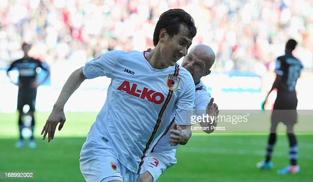 DongWon Ji and Tobias Werner of Augsburg celebrate the third goal during the Bundesliga match between FC Augsburg and SpVgg Greuther Fuerth at SGL...
