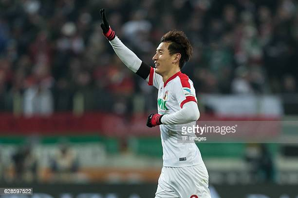 DongWon Ji of Augsburg celebrates after scoring during the Bundesliga match between FC Augsburg and Eintracht Frankfurt at WWK Arena on December 4...