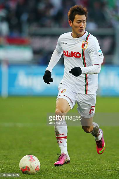 DongWon Ji of Augsburg controles the ball during the Bundesliga match between FC Augsburg and 1 FSV Mainz 05 at SGL Arena on February 10 2013 in...