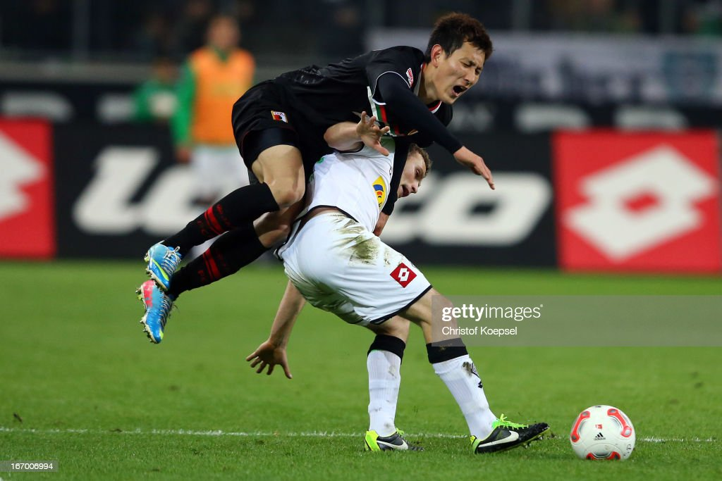 Dong-Won Ji of Augsburg fouls <a gi-track='captionPersonalityLinkClicked' href=/galleries/search?phrase=Tony+Jantschke&family=editorial&specificpeople=4158344 ng-click='$event.stopPropagation()'>Tony Jantschke</a> of Moenchengladbach during the Bundesliga match between VfL Borussia Moenchengladbach and FC Augsburg at Borussia Park Stadium on April 19, 2013 in Moenchengladbach, Germany.
