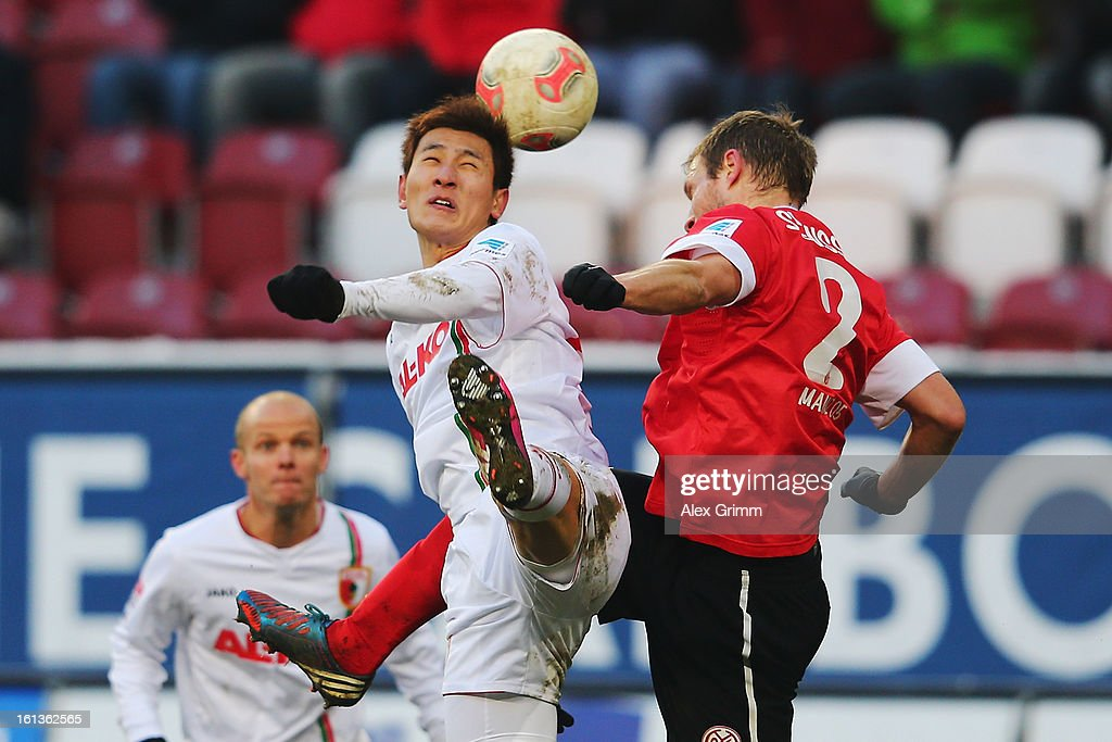 Dong-Won Ji (L) of Augsburg is challenged by <a gi-track='captionPersonalityLinkClicked' href=/galleries/search?phrase=Bo+Svensson&family=editorial&specificpeople=635188 ng-click='$event.stopPropagation()'>Bo Svensson</a> of Mainz during the Bundesliga match between FC Augsburg and 1. FSV Mainz 05 at SGL Arena on February 10, 2013 in Augsburg, Germany.