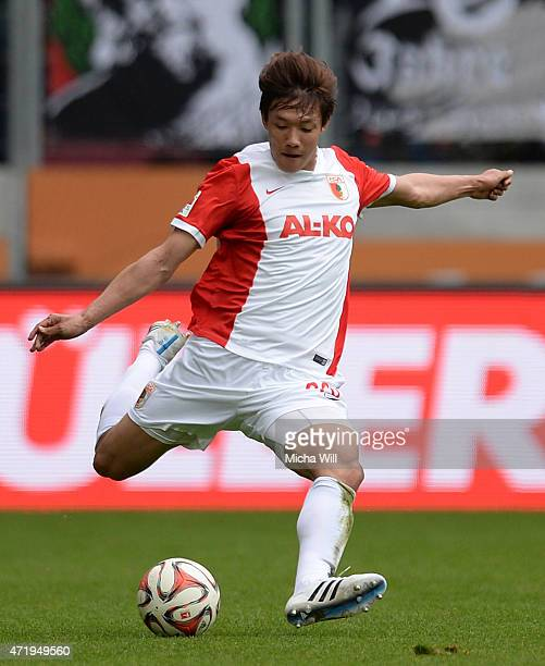 DongWon Ji of Augsburg kicks the ball during the Bundesliga match between FC Augsburg and 1 FC Koeln at SGL Arena on May 2 2015 in Augsburg Germany