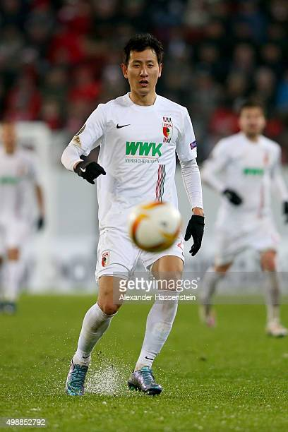 DongWon Ji of Augsburg runs with the ball during the UEFA Europa League Group L match between FC Augsburg and Athletic Club at WWKArena on November...