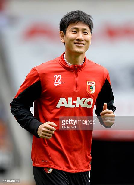 DongWon Ji of Augsburg warms up prior to the Bundesliga match between FC Augsburg and 1 FC Koeln at SGL Arena on May 2 2015 in Augsburg Germany