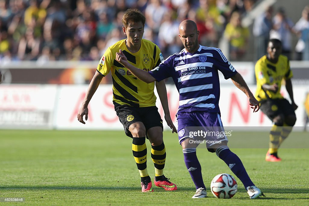 Dong-Won Ji of Dortmund challenges Sofien Chahed of Osnabrueck during the friendly match between VfL Osnabrueck and Borussia Dortmund at Osnatel Arena on July 22, 2014 in Osnabrueck, Germany.