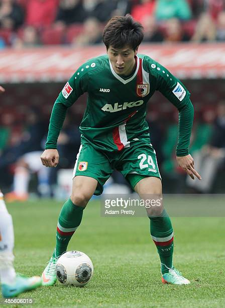 DongWon Ji of FC Augsburg in action during the Bundesliga match between FC Augsburg and Hertha BSC at SGL Arena on April 19 2014 in Augsburg Germany