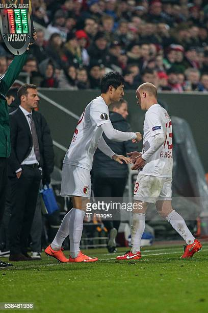 DongWon Ji of FC Augsburg shakes hands with Tobias Werner of FC Augsburg during the UEFA Europa League match between FC Augsburg and Liverpool at WWK...