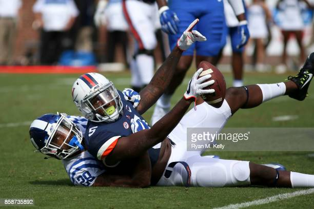 Doni Dowling of the Virginia Cavaliers signals for a touchdown which was confirmed after review as he is tackled by Mark Gilbert of the Duke Blue...