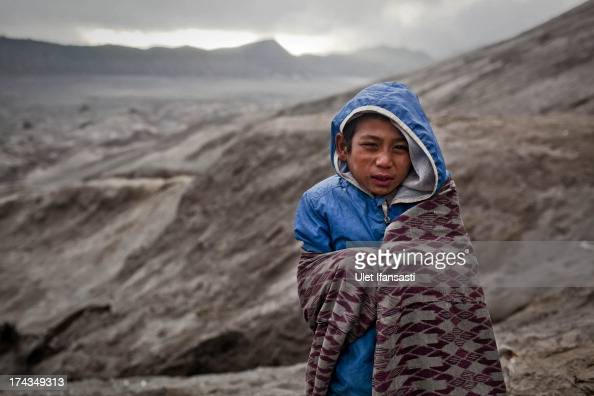 Doni stands at foot of Mount Bromo during the Yadnya Kasada Festival at crater of Mount Bromo on July 24 2013 in Probolinggo East Java Indonesia The...