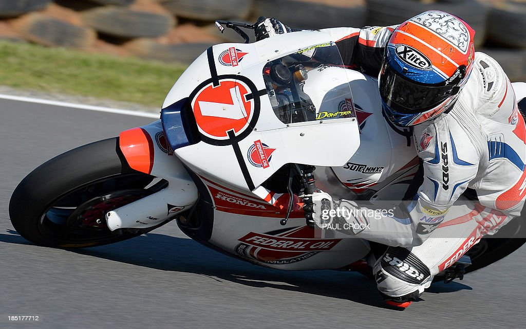 Doni Tata Pradita of Indonesia races his Suter through a corner during practice for the Australian Moto2 Grand Prix at Phillip Island on October 18, 2013. AFP PHOTO/Paul Crock USE