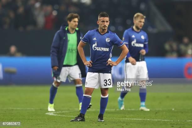 Donis Avdijaj of FC Schalke 04 and team mates look dejected after the UEFA Europa League quarter final second leg match between FC Schalke 04 and...