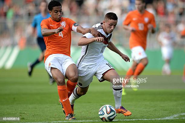 Donis Avdijaj of Germany is challenged by Jairo Riedewald of Netherlands during the international friendly match between U19 Germany and U19...