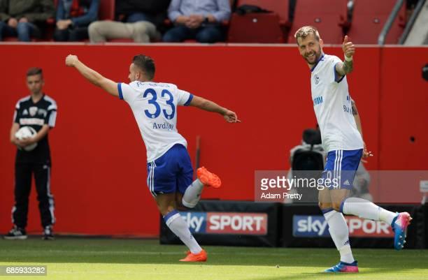 Donis Avdijaj of Schalke 04 celebrates with Guido Bergstaller of Schalke 04 after scoring a goal during the Bundesliga match between FC Ingolstadt 04...