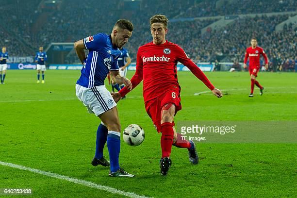 Donis Avdijaj of Schalke and Bastian Oczipka of Eintracht Frankfurt battle for the ball during the Bundesliga match between FC Schalke 04 and...