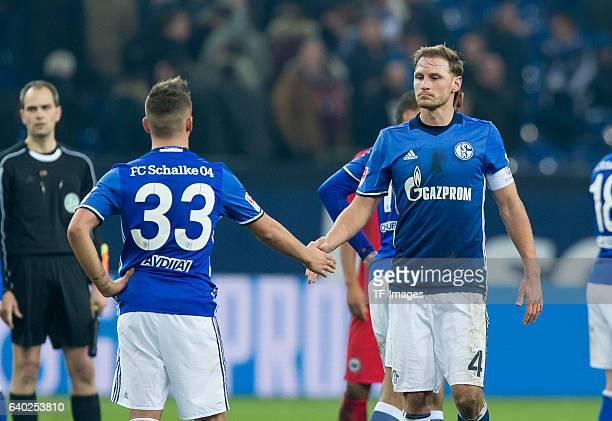 Donis Avdijaj of Schalke and Benedikt Hoewedes of Schalke disappointede during the Bundesliga match between FC Schalke 04 and Eintracht Frankfurt at...