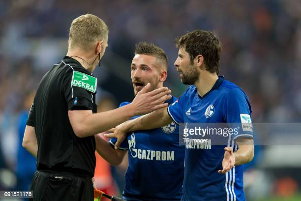 Donis Avdijaj of Schalke and Coke of Schalke during to the Bundesliga match between FC Schalke 04 and Hamburger SV at VeltinsArena on May 13 2017 in...
