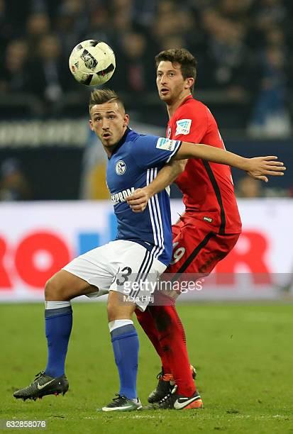 Donis Avdijaj of Schalke and David Abraham of Frankfurt battle for the ball during the Bundesliga match between FC Schalke 04 and Eintracht Frankfurt...