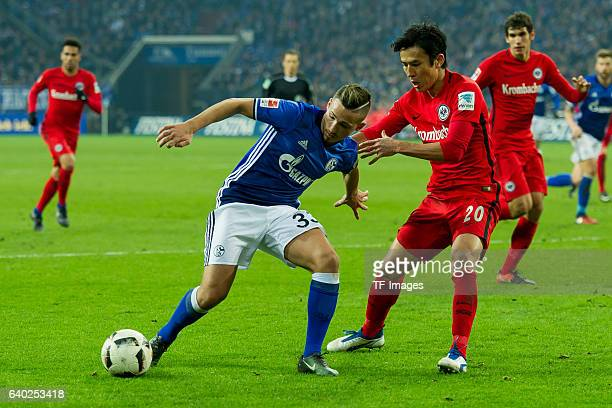 Donis Avdijaj of Schalke and Makoto Hasebe of Eintracht Frankfurt battle for the ball during the Bundesliga match between FC Schalke 04 and Eintracht...