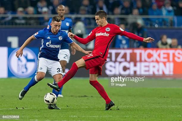 Donis Avdijaj of Schalke and Mijat Gacinovic of Eintracht Frankfurt battle for the ball during the Bundesliga match between FC Schalke 04 and...
