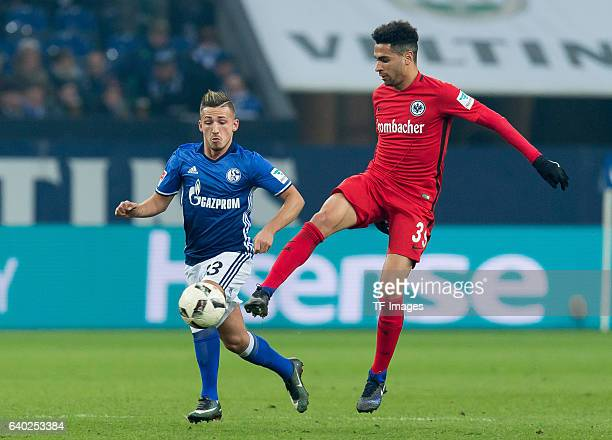 Donis Avdijaj of Schalke and Omar Mascarell of Eintracht Frankfurt battle for the ball during the Bundesliga match between FC Schalke 04 and...