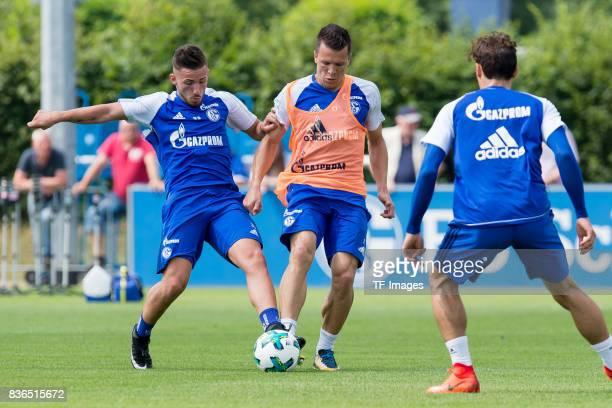 Donis Avdijaj of Schalke and Yevhen Konoplyanka of Schalke battle for the ball during a training session at the FC Schalke 04 Training center on July...