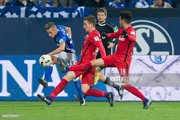 Donis Avdijaj of Schalke Bastian Oczipka of Eintracht Frankfurt and Omar Mascarell of Eintracht Frankfurt battle for the ball during the Bundesliga...