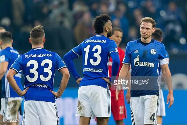 Donis Avdijaj of Schalke Eric Maxim ChoupoMoting of Schalke and Benedikt Hoewedes of Schalke disappointede during the Bundesliga match between FC...