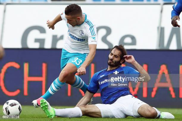 Donis Avdijaj of Schalke is challenged by Hamit Altintop of Darmstadt during the Bundesliga match between SV Darmstadt 98 and FC Schalke 04 at...