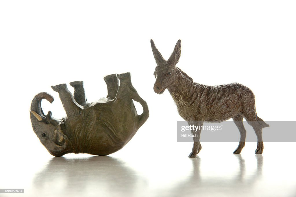 Donkey and defeated elephant miniatures : Stock Photo