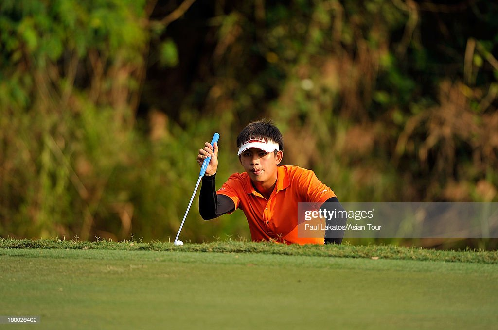Donlaphatchai Niyomchon of Thailand plays a shot during round three of the Asian Tour Qualifying School Final Stage at Springfield Royal Country Club on January 25, 2013 in Hua Hin, Thailand.