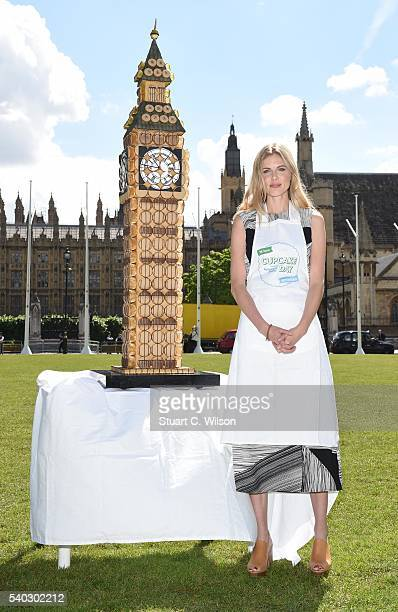 Donna Air and the Alzheimer's Society create a giant Big Ben in cupcakes to mark Cupcake Day at Parliament Square on June 15 2016 in London England