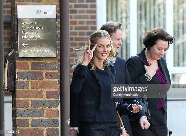 Donna Air gestures as she leaves Isleworth Crown Court with her legal team after being acquitted of parking permit fruad on March 29 2012 in London...