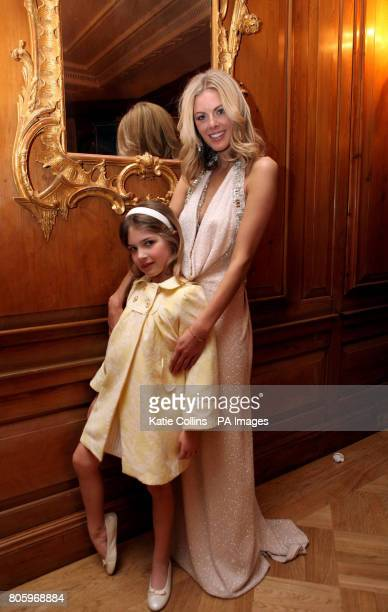 Donna Air wears a Bruce Oldfield dress with daughter Freya backstage at The Dorchester Hotel for The Goldilocks Fashion Show in aid of Kids Company