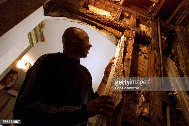 Donna and Russell Merriweather examine wood rot and termite damage in closet and the rear wall of their home on Martin Luther King Blvd which escaped...
