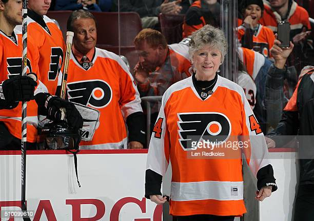 Donna Ashbee walks to center ice for a pregame ceremony to unveil the new 50th anniversary logo prior to the Philadelphia Flyers game against the...