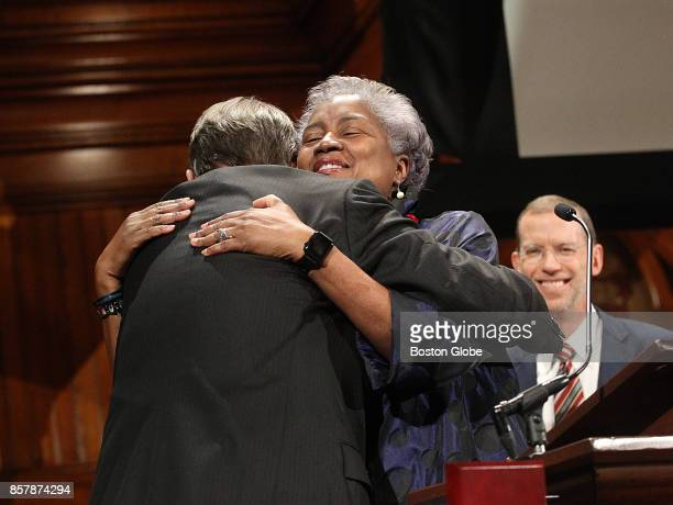 Donna Brazile gets a hug after receiving her award during the W E B Du Bois Medal Ceremony at the fifth annual Hutchins Center Honors at Harvard...